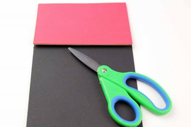scissor and red and black construction paper