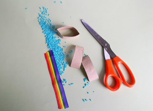 colored rice, rainbow ribbon and scissors