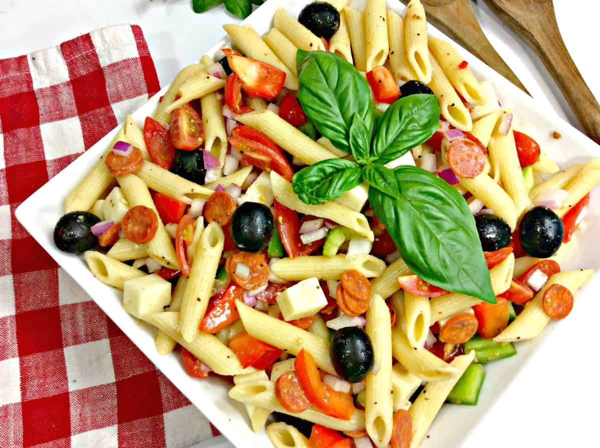 pasta salad with olives and cheese on a plate