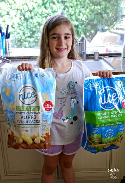 child holding Nice! products