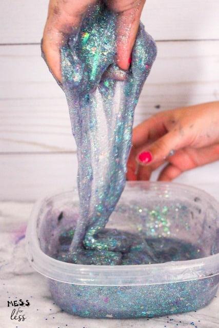 kneading glitter slime