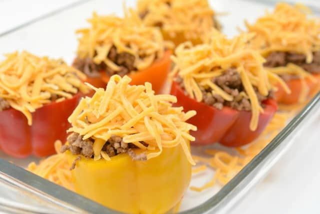 shredded cheese on top of stuffed peppers