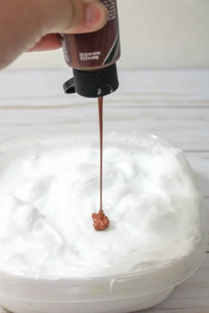 adding brown paint to slime