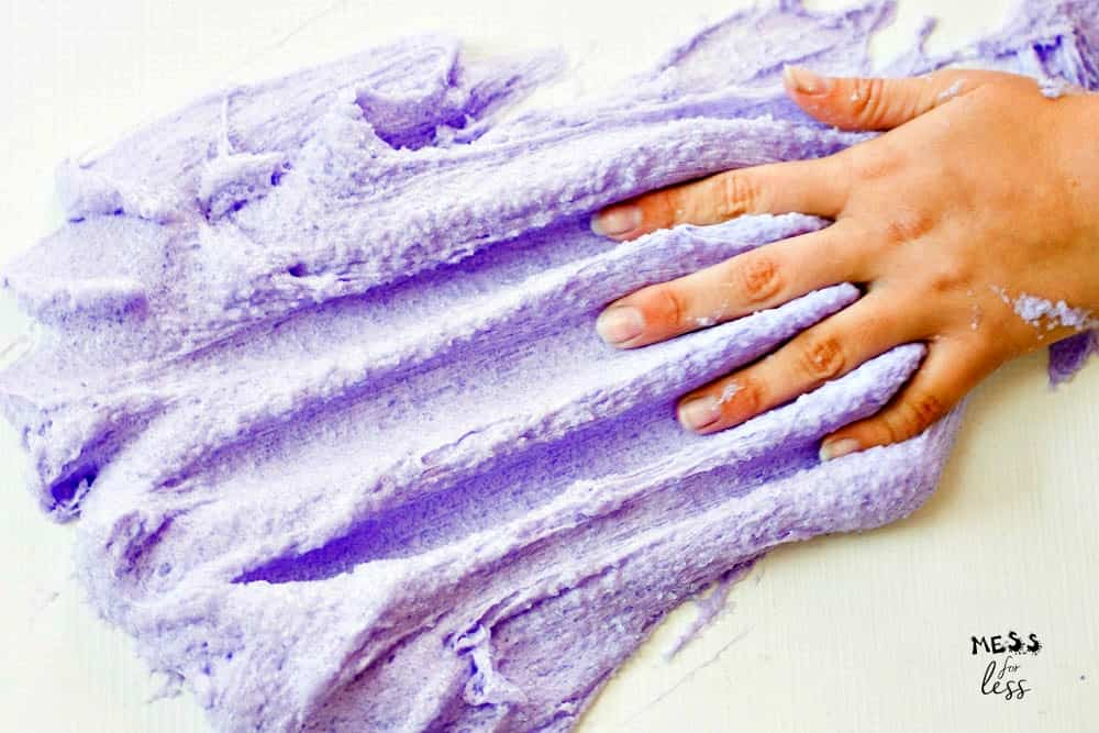 hand touching purple cloud slime