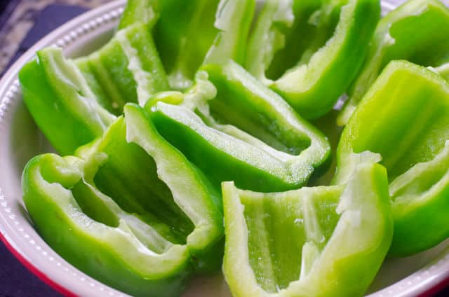 cut green peppers in a pan