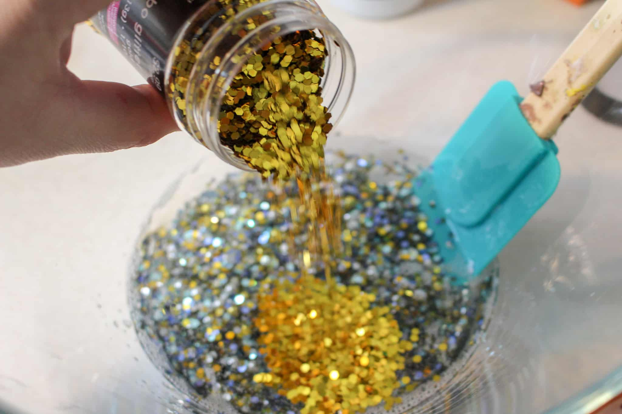 adding glitter to slime