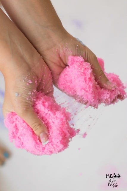 hands stretching pink cloud slime