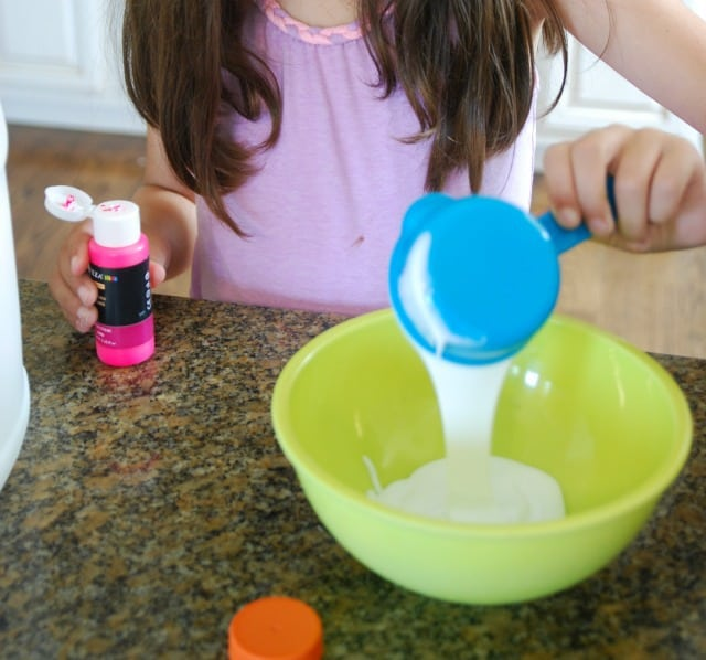 pouring glue into a bowl