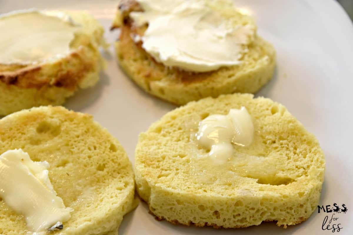 slices of keto bread in a mug with butter and cream cheese