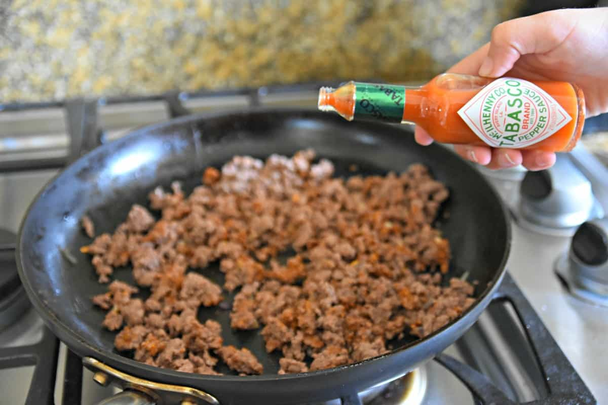 #ad adding Tabasco to ground beef