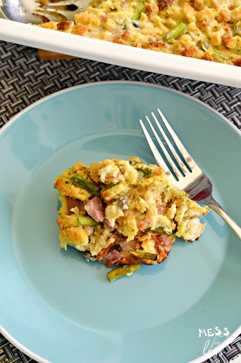 ham and asparagus casserole recipe with fork and blue plate