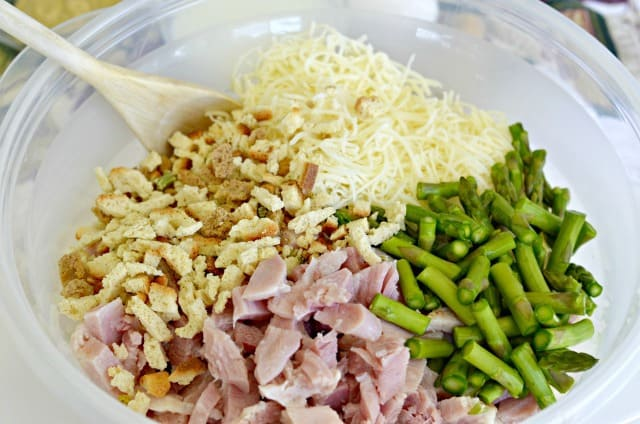 stuffing mix, ham, asparagus and cheese in a bowl