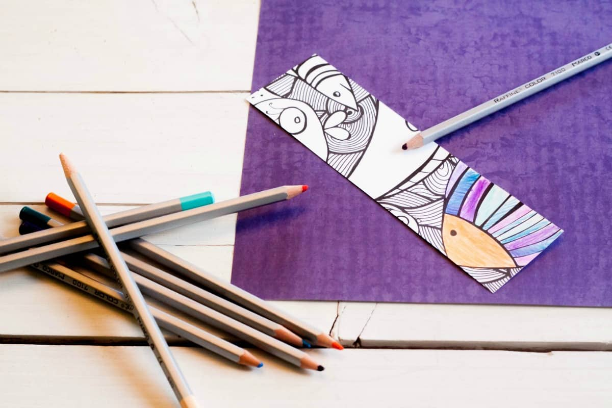 coloring a bookmark with a colored pencil