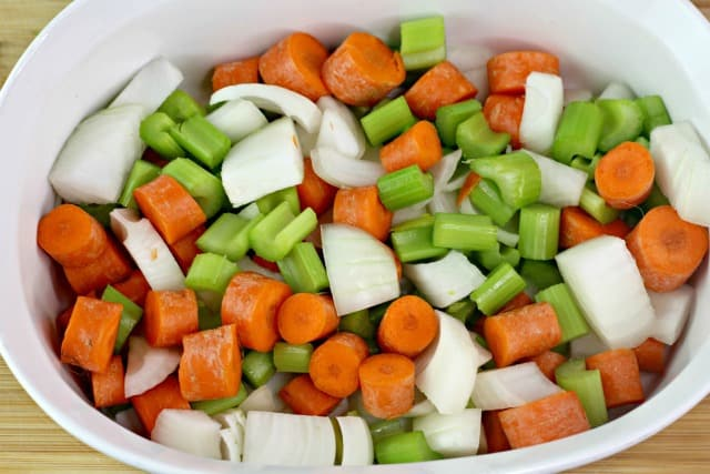 celery carrots and onions in a casserole dish