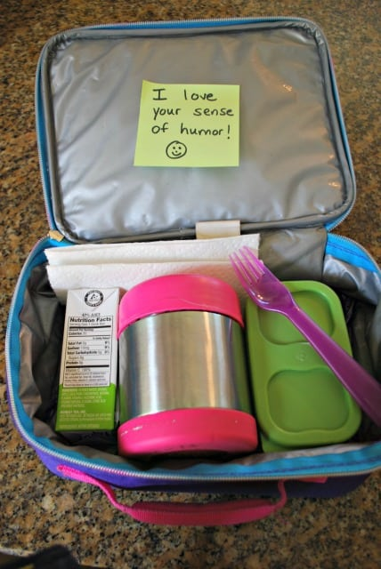 child's lunch box with a thermos