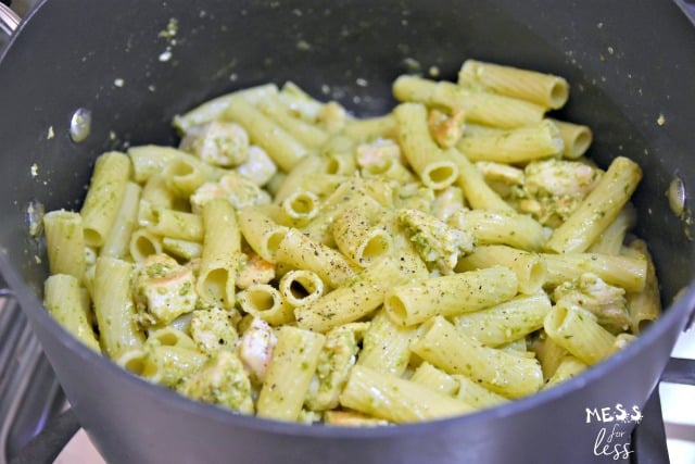 pasta and pesto and chicken in a pot