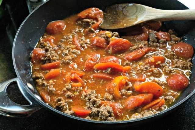 ground beef and tomatoes in a pan