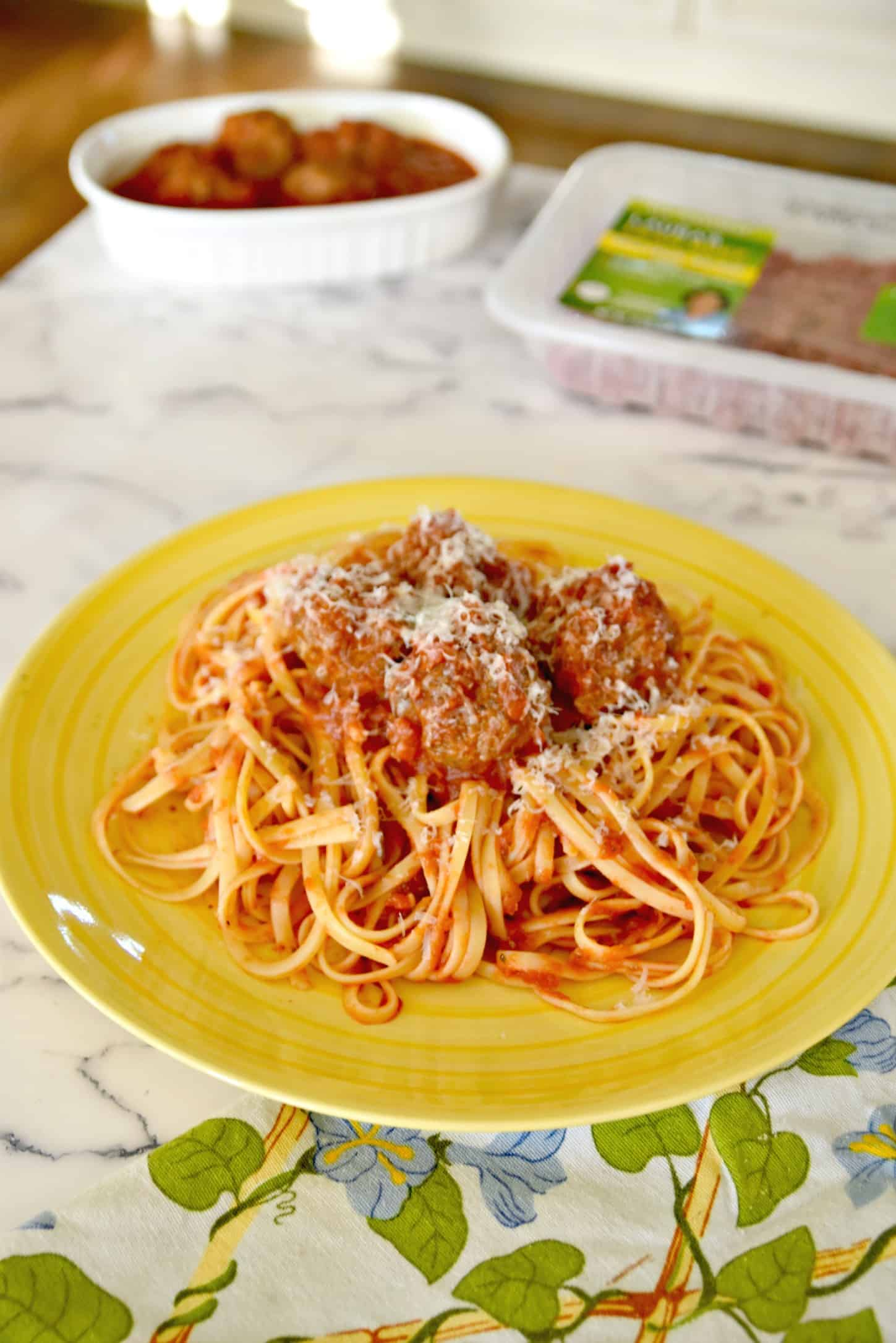 spaghetti and meatballs with Parmesan cheese