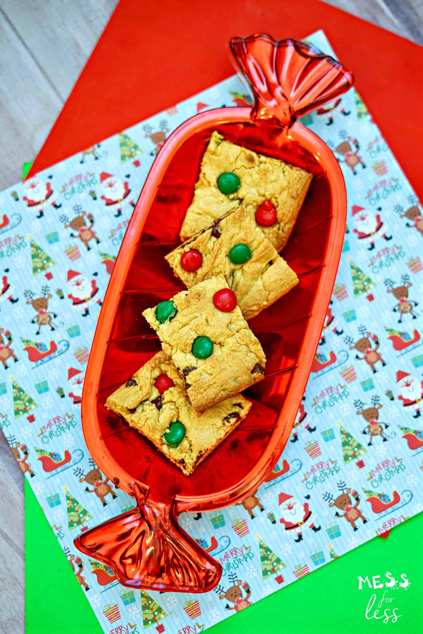 easy christmas cookie cake bars in a red serving dish