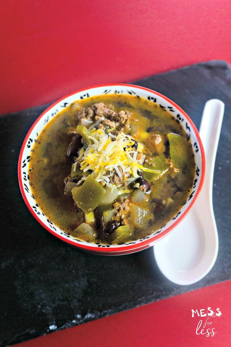 taco soup in a bowl topped with shredded cheese
