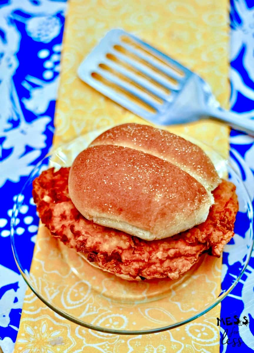 crispy buttermilk fried chicken sandwich on plate with spatula