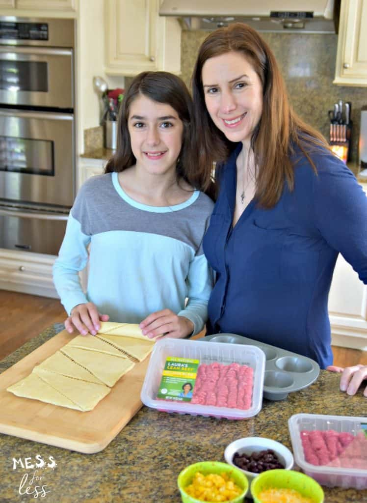 mom and child with rolled crescent rolls