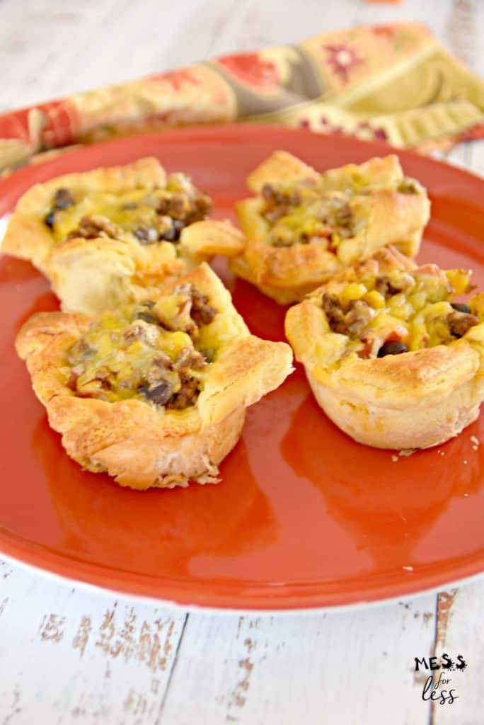 cheesy beef taco crescent cups on a red plate