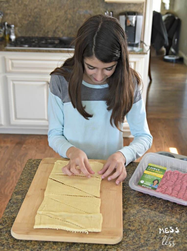 child making crescent rolls