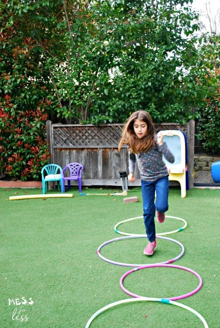 child playing with hula hoops
