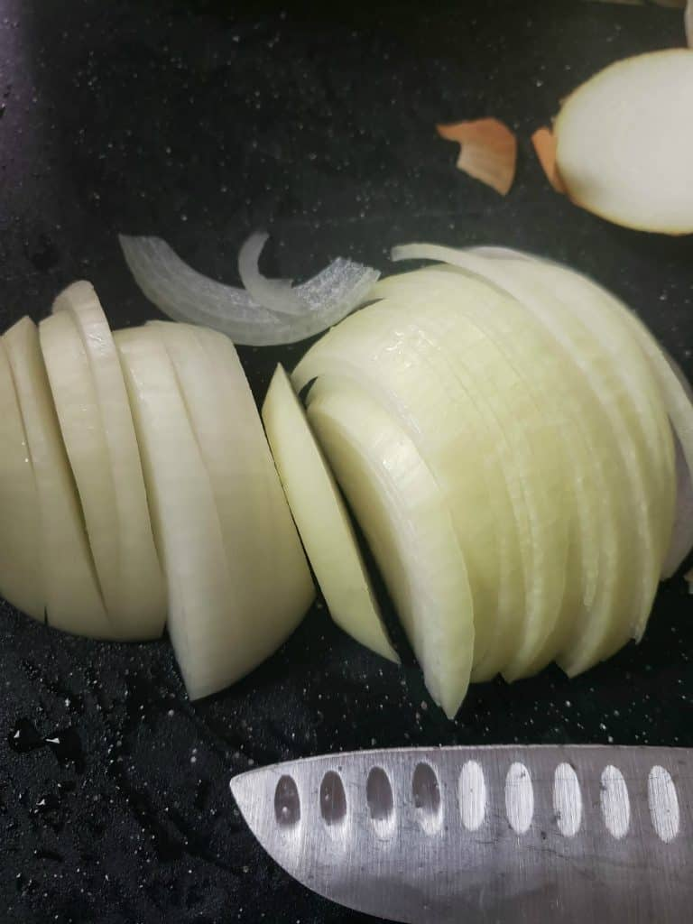 slicked onions on a cutting board