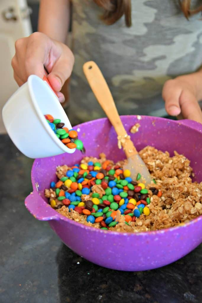 adding m&ms to Monster Cookie Energy Balls