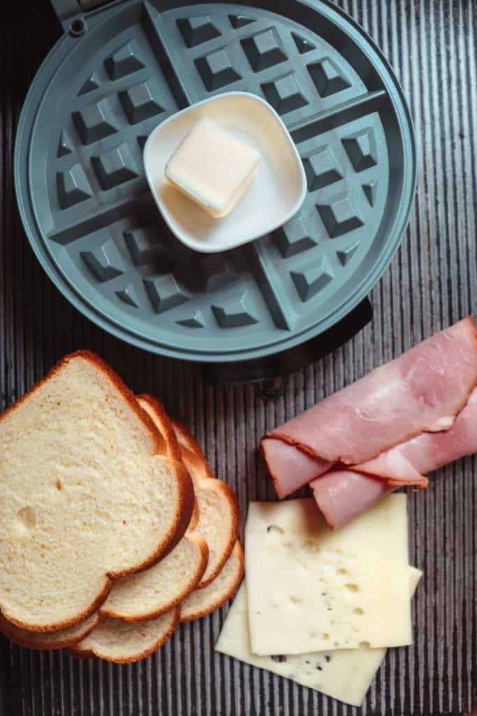 waffle maker, ham, bread and butter