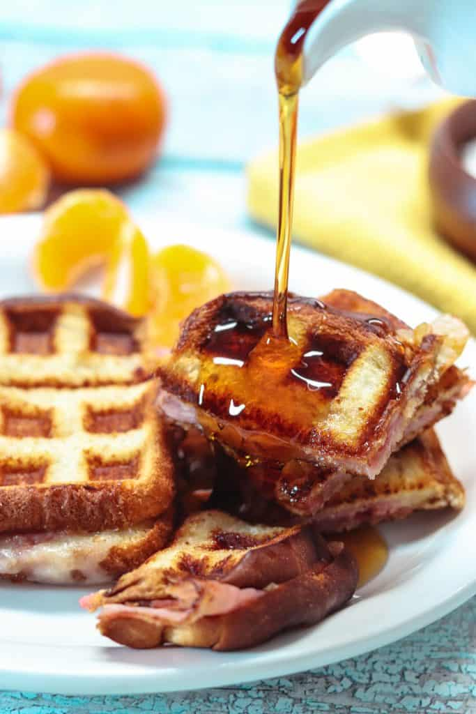 pouring syrup on a monte cristo sandwich