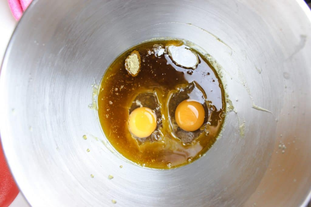 eggs, melted butter, sugar in a bowl