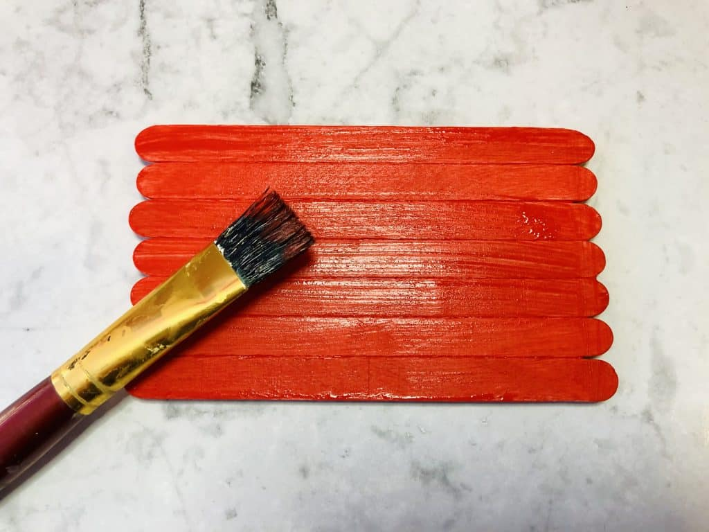 red painted popsicle sticks
