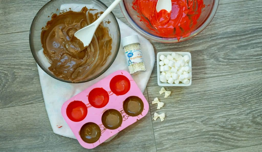 melted candy melts and hot cocoa bomb molds