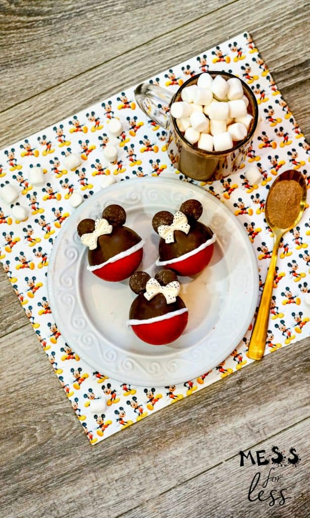 minnie mouse hot chocolate bombs on a white plate