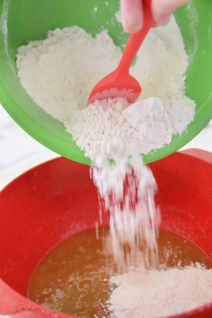 flour being poured into a bowl