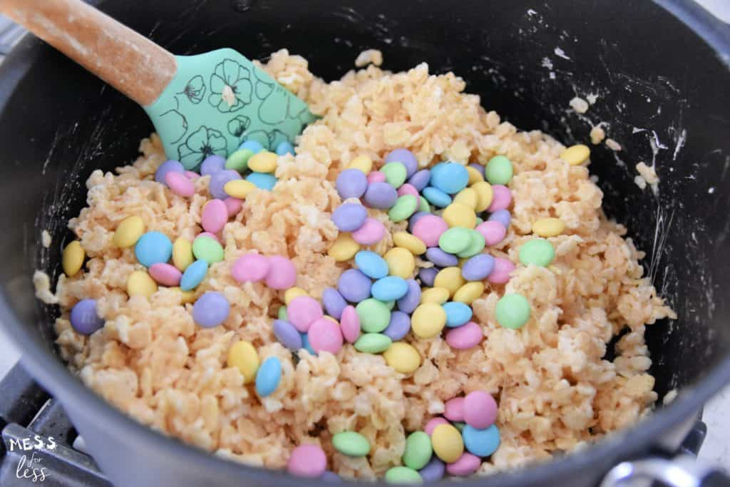 M&Ms and rice krispies in a sauce pan