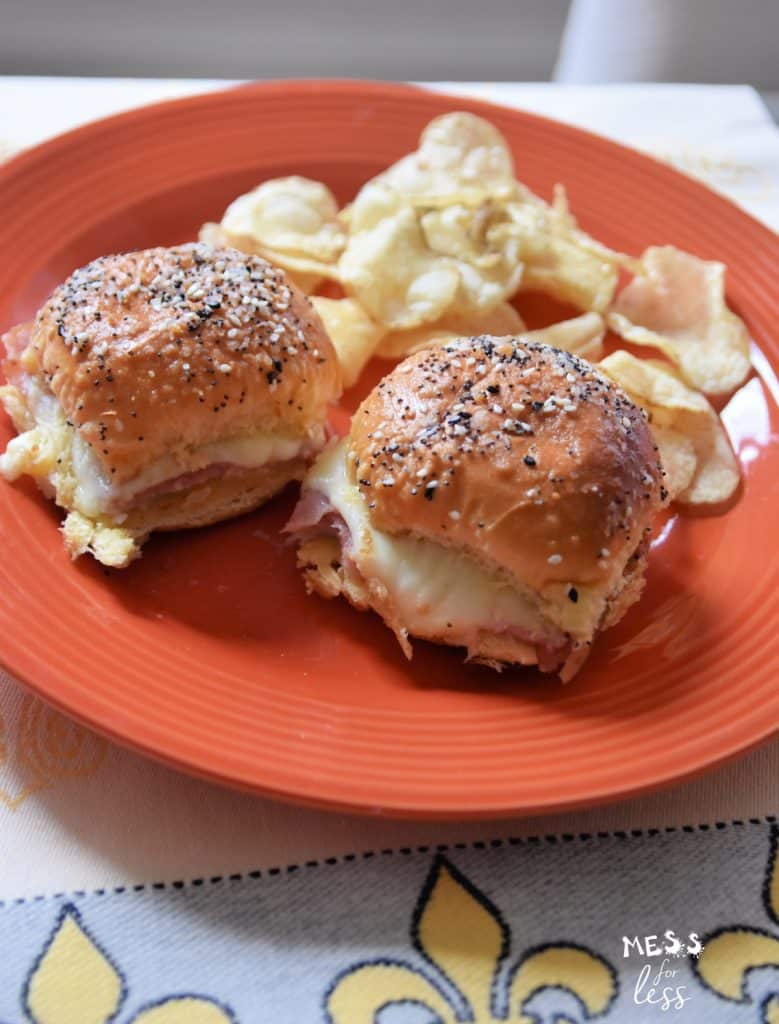 ham and cheese sliders on a plate with potato chips