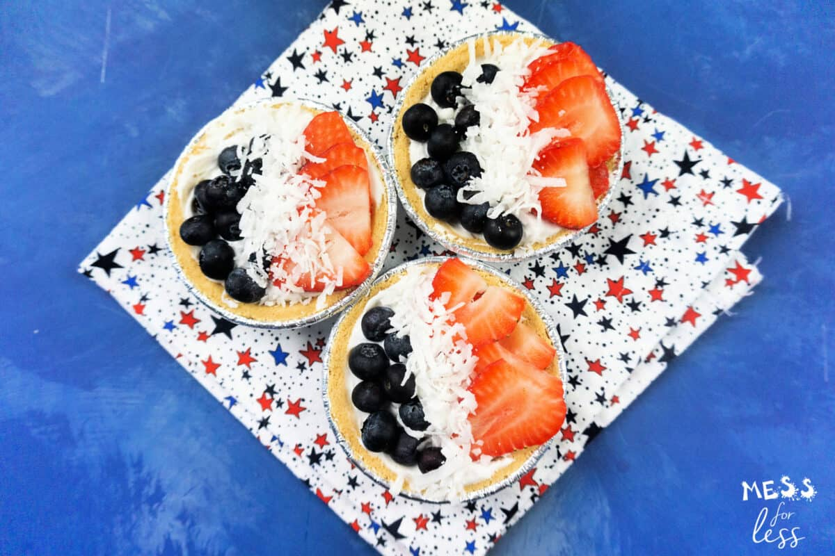 mini pies with blueberries, coconut and strawberries
