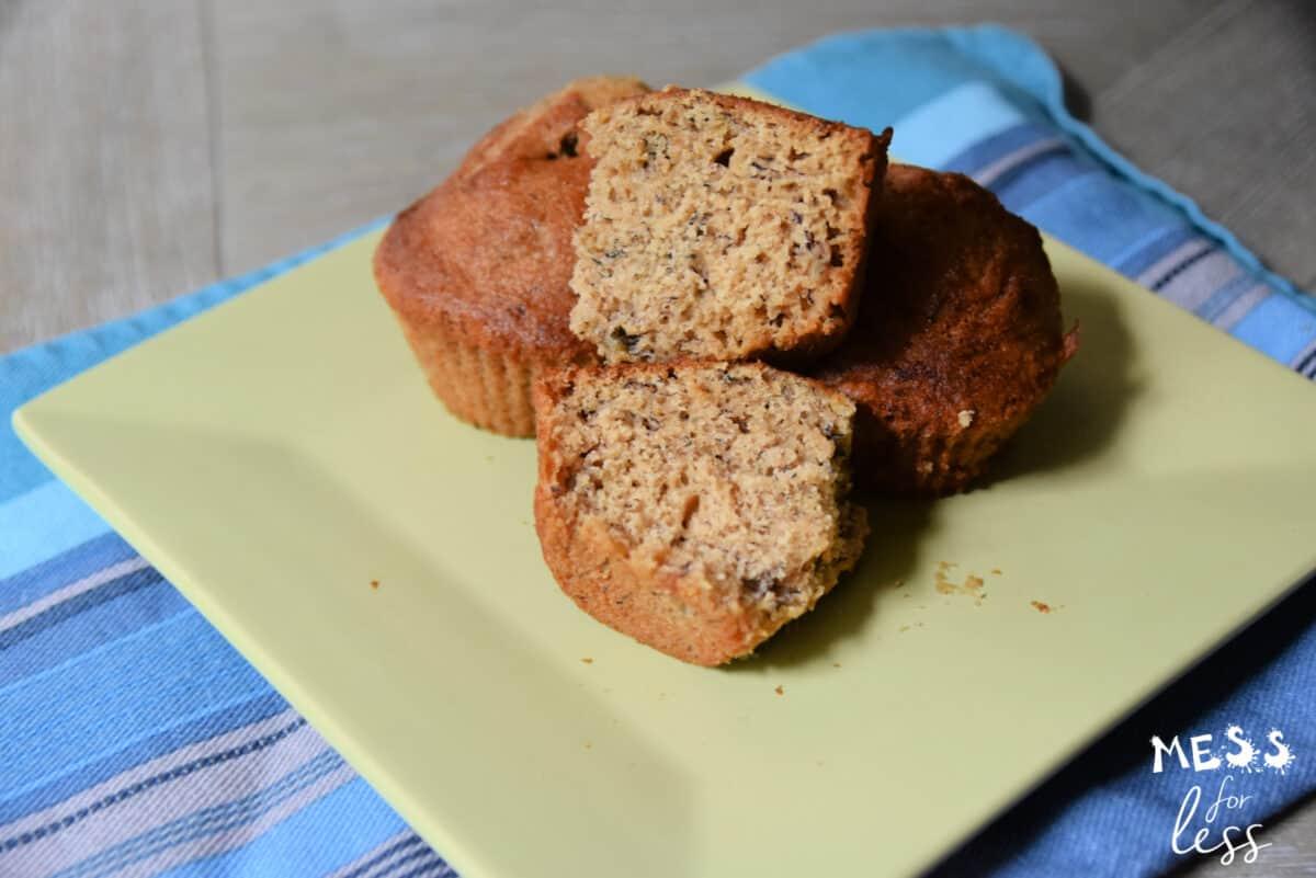 banana muffins on a plate on a blue napkin