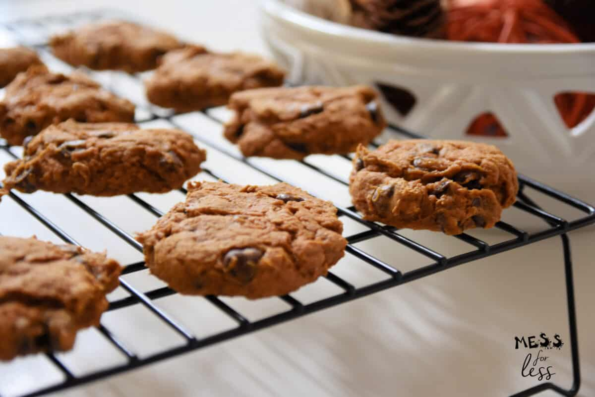 pumpkin spice cookies with chocolate chips on cooling rack