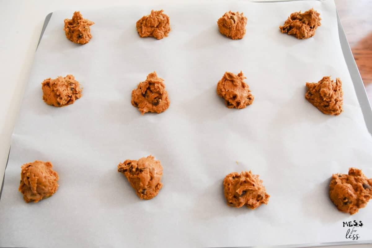 pumpkin cookies on a cookie sheet